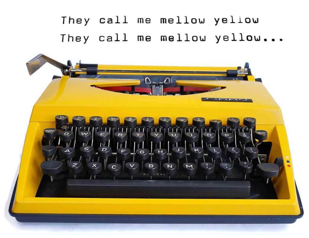 They Call Me Mellow Yellow Typed on a Yellow Triumph Tippa Typewriter