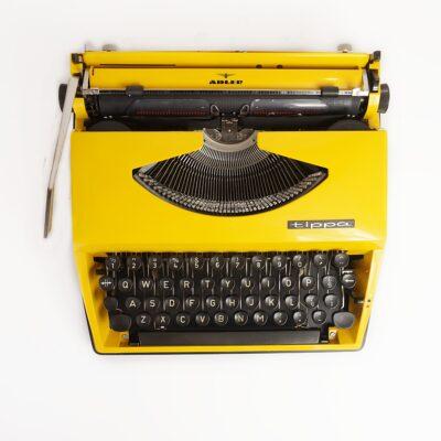 Yellow Adler Tippa Typewriter