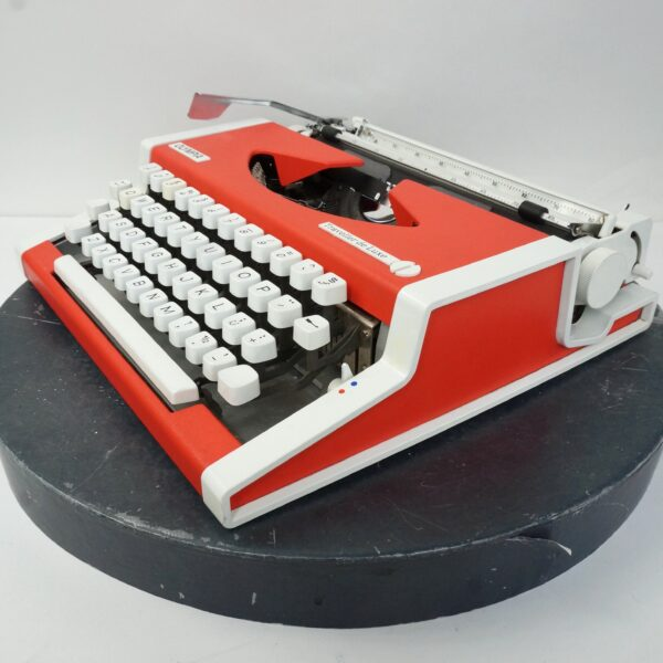 Orange Olympia traveller typewriter